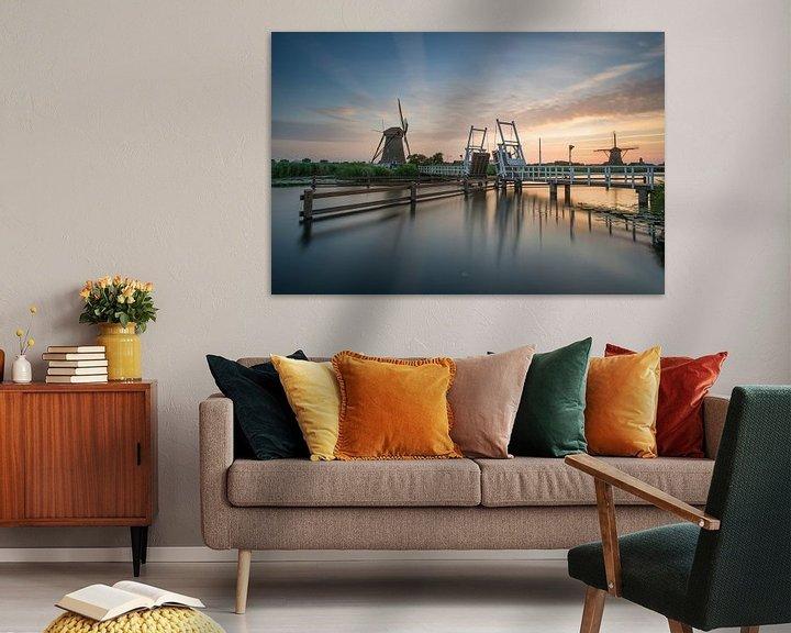 Sfeerimpressie: Zonsondergang in Kinderdijk van Raoul Baart