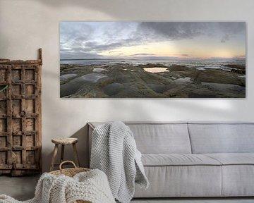 Rotsige kust met ondergaande zon in Australië van Ingrid Meuleman