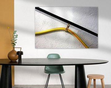 Rampe murale pour tuyau d'arrosage