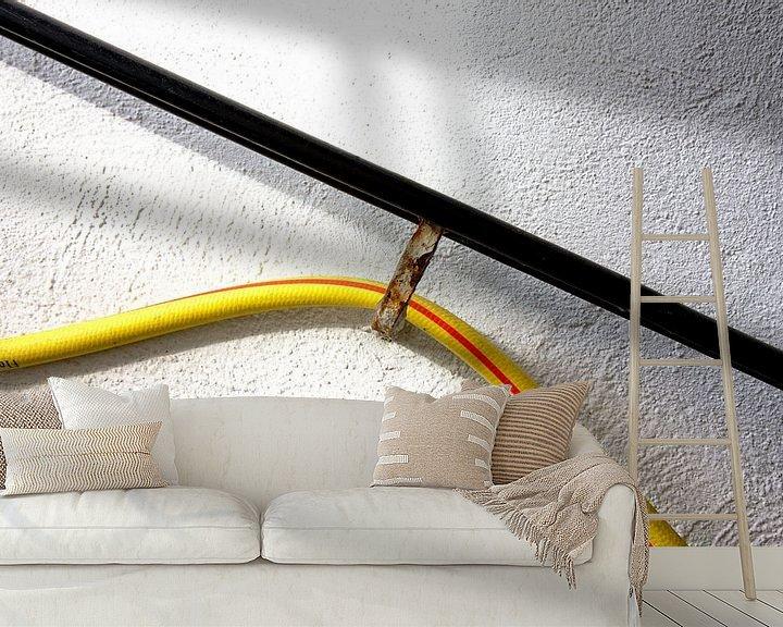 Impression: Rampe murale pour tuyau d'arrosage sur Jan Brons