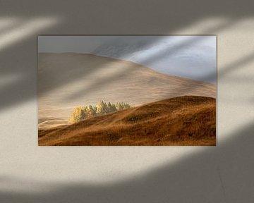 De zon die door breekt in de Schotse hooglanden van Guido Boogert