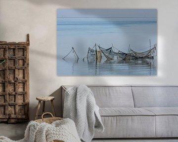 oude visnetten in de Waddenzee van Harry Siegers