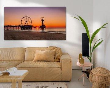 De Pier in Scheveningen tijdens het gouden uurtje van de zonsondergang van Arisca van 't Hof
