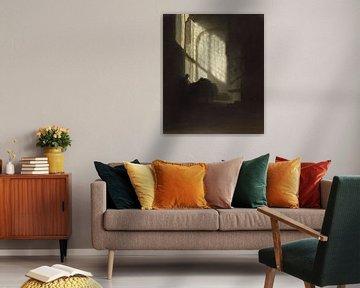 Een man zittend en lezend aan een tafel in een hoge kamer, volger van Rembrandt