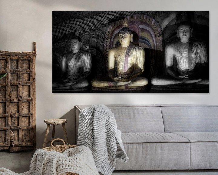 Sfeerimpressie: Drie boeddha's in lotushouding van Eddie Meijer