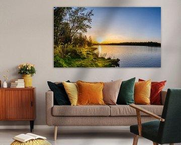 Beautiful sunset on a natural lake van Günter Albers