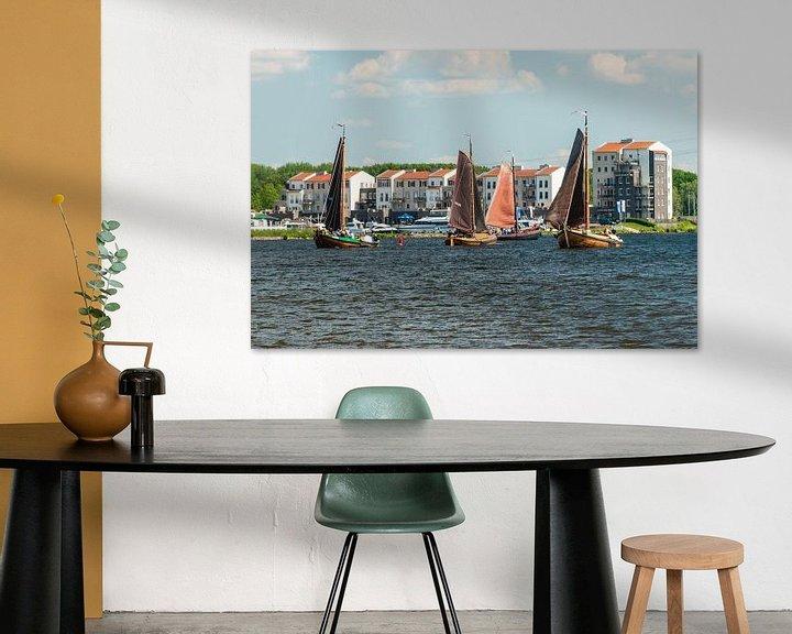 Sfeerimpressie: Botters voor de kust bij Spakenburg. van Brian Morgan