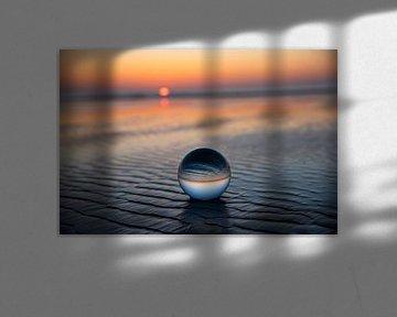 Ameland zonsondergang met glazen bol van Coby Bergsma