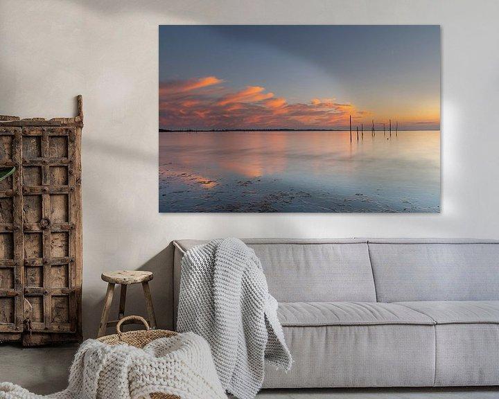 Beispiel: Reflektierender Sonnenuntergang mit Pfosten von Bas Verschoor