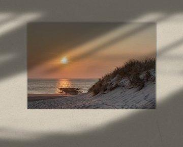 zonsondergang aan het strand van Frans Bruijn