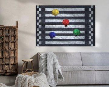 Vier gekleurde paraplu's op zebrapad van Marcel van Balken