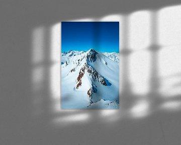 Besneeuwde Tiroler Alpen in Oostenrijk tijdens een prachtige winterdag van Sjoerd van der Wal