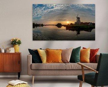 """Zonsondergang boven molen """"De Rat"""" gelegen aan de Geeuw in IJlst van Wout Kok"""