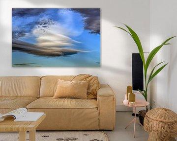Een lenticularis wolk met een blauwe lucht als achtergrond van Harrie Muis
