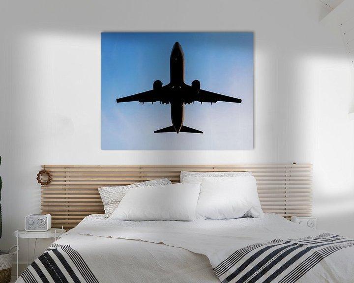 Impression: Un avion dans le ciel sur Frank Herrmann