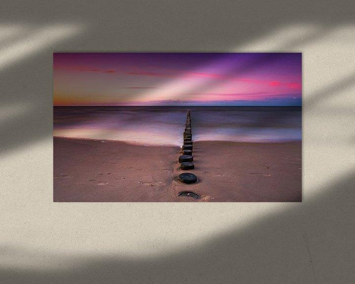 Sfeerimpressie: Kribben aan zee bij zonsondergang van Frank Herrmann