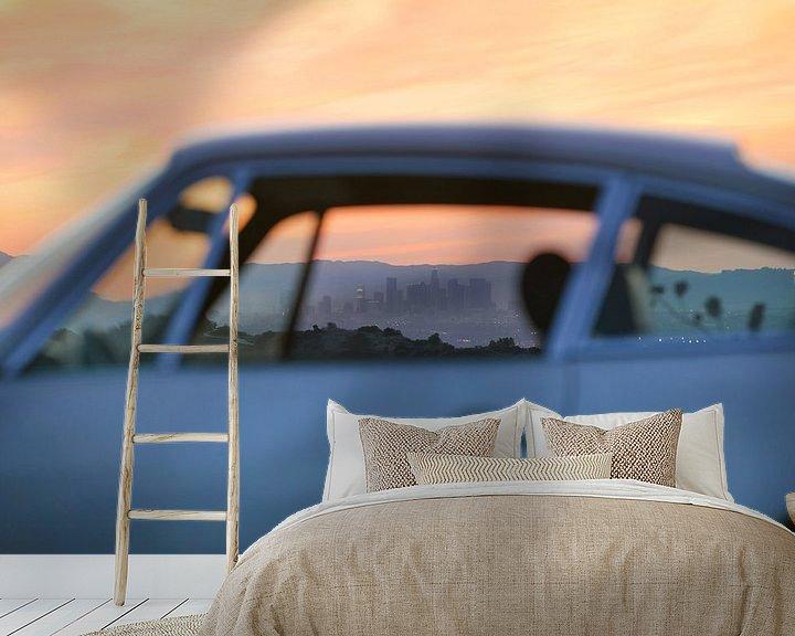 Sfeerimpressie behang: LA skyline through the window of a 911 van Maurice van den Tillaard