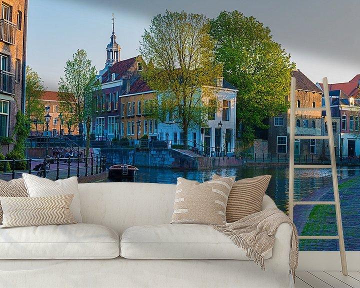 Sfeerimpressie behang: Zonsondergang over de oude binnenstad van Schiedam van Marc de IJk