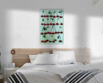 Trosjes kersen op tuquoise achtergrond 12571357 van BeeldigBeeld Food & Lifestyle