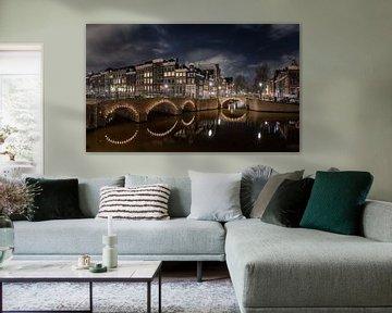 grachten van Amsterdam in de nacht van Robin van Maanen