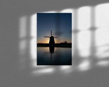 De molens bij Schermerhorn tijdens zonsondergang van Paul Veen