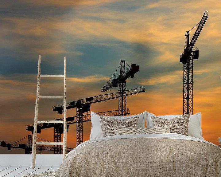 Impression: Grues de chantier au coucher du soleil sur Frank Herrmann