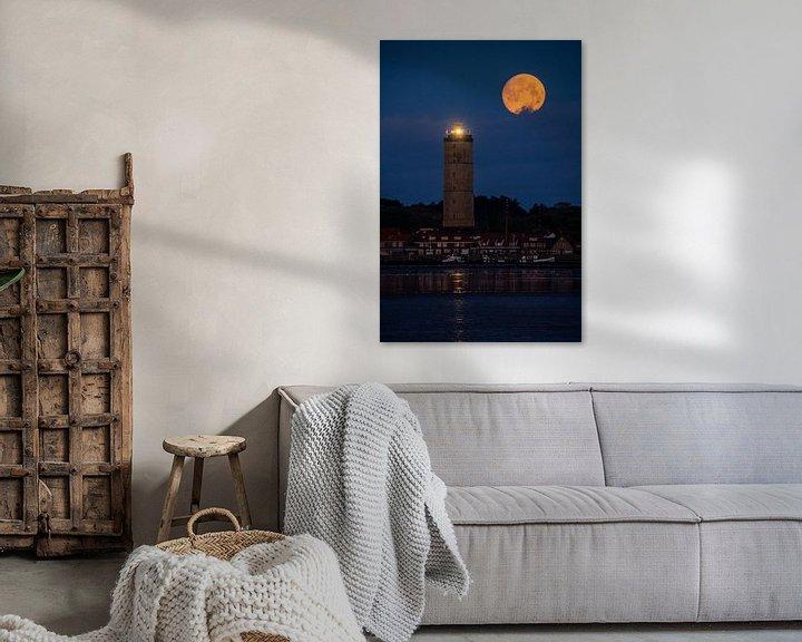 Sfeerimpressie: Volle maan boven de Brandaris van Marjolein van Roosmalen