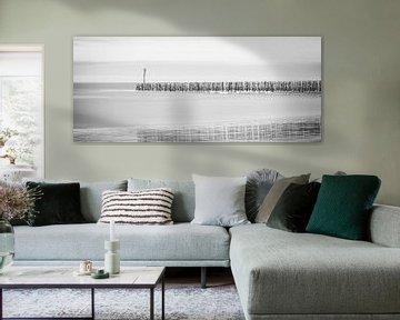 zee met paaltjes van Kay Mezarina Photography