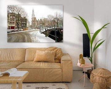 Auf den schneebedeckten Grachten von Amsterdam von Nisangha Masselink