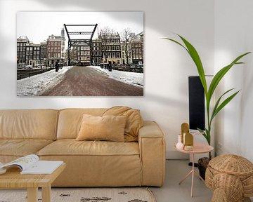 Das verschneite Amsterdam im Winter in den Niederlanden von Nisangha Masselink