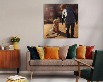jongen en hond bezig met trucjes van Kim Groenendal