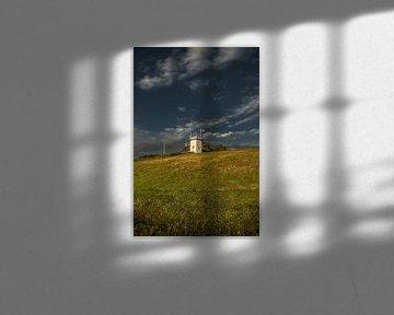 Le phare de la ville frisonne de Workum dans la lumière du soir sur Harrie Muis