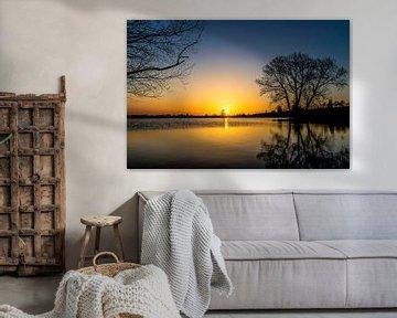 Zonsondergang in Nederland bij het water van Devlin Jacobs