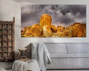 Oranje gekleurde graniet rotsen in Namibië van Chris Stenger
