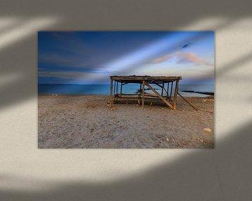 Oud huisje op het strand