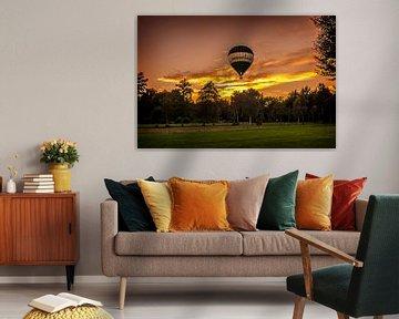 Ballonvaart met zonsondergang  van Marcel Braam