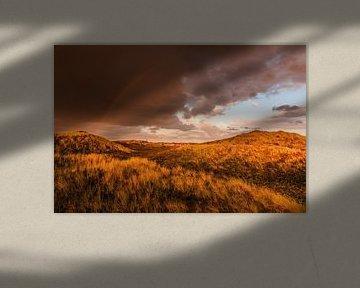 Duinlandschap met regenboog op Sylt van Christian Müringer