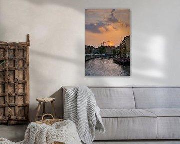 Bloemenmarkt zonsondergang Amsterdam van Alex van der Aa