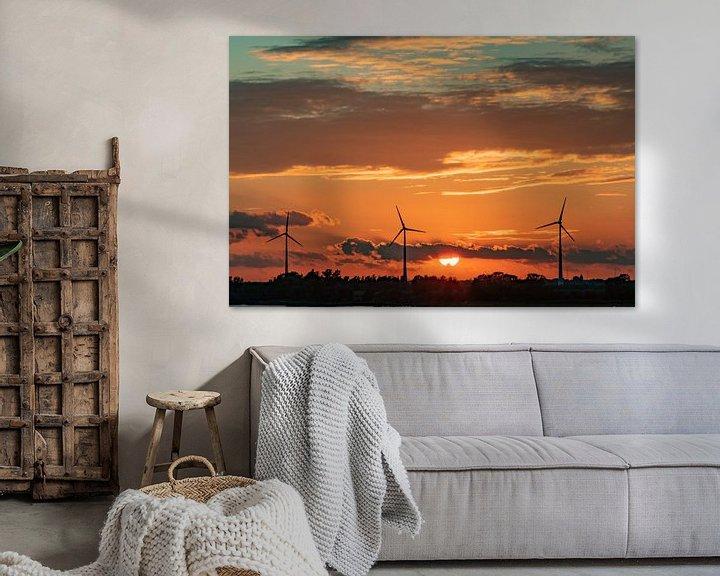 Sfeerimpressie: Windmolens in de avondzon van Arie Jan van Termeij