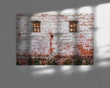 Oude bakstenen muur van Anjo ten Kate