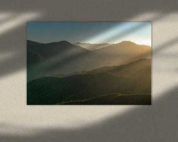 Zonsondergang in de bergen van Robert de Boer