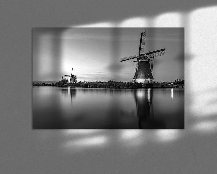Sfeerimpressie: Verlichtte molen bij zonsondergang van Henri van Avezaath
