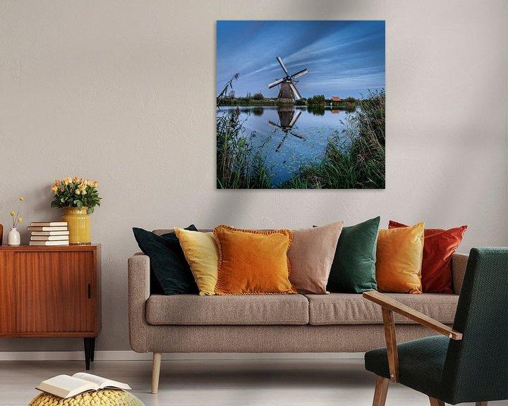 Sfeerimpressie: Weerspiegeling van een molen in het water van Henri van Avezaath