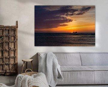 zonsondergang met schip van John Driessen