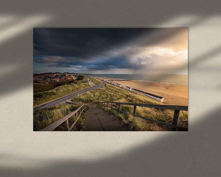 Sfeerimpressie: Dreigende wolkenlucht met zicht over Zoutelande van Thom Brouwer