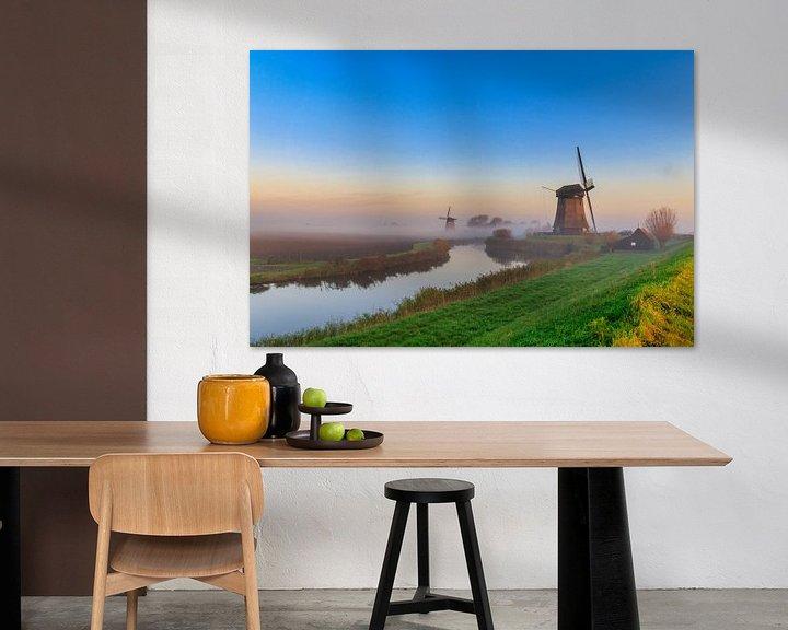 Sfeerimpressie: Kleurrijke zonsopgang bij de molens in de Schermer van Photo Henk van Dijk