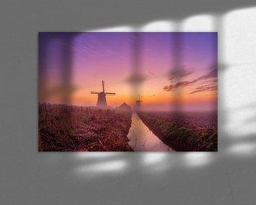Kleurrijke zonsopkomst bij de Schermer molens van Photo Henk van Dijk