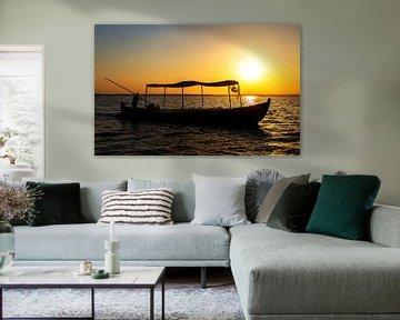 Fischerboot im Sonnenuntergang