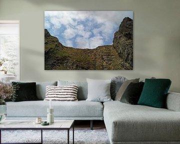 Ciel nuageux sur une paroi rocheuse. sur Babetts Bildergalerie