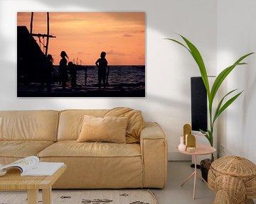 Zonsondergang in vissersdorp Indonesië II von André van Bel